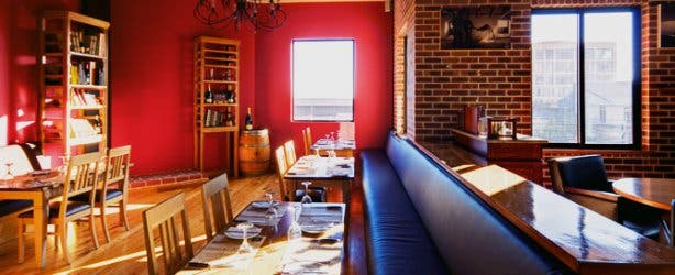 The Local Grill interior red wall