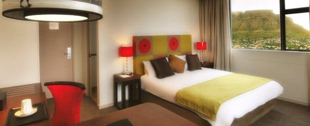 Deluxe room at accommodation at the Strand Hotel