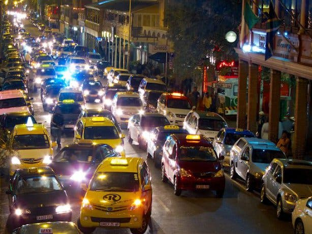 taxi cars long street at night