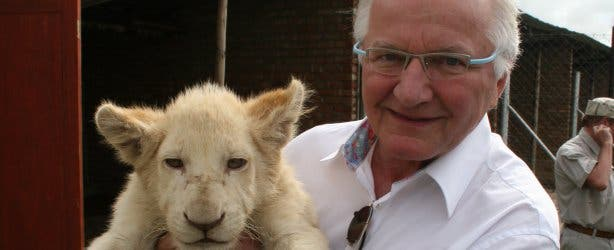 Austrian Consul General Otto Strehlik with a lion cub