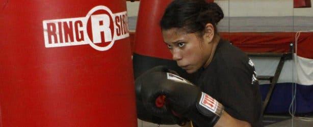 Boxing Woman and Punching Bag