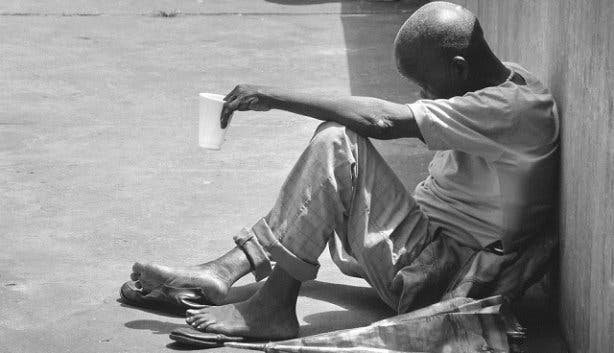 Beggar sitting in the street