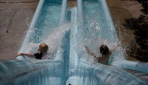 Waterworld Strand Children on slide