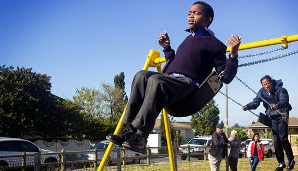 Blind-Friendly Outdoor Park Swing and Boy