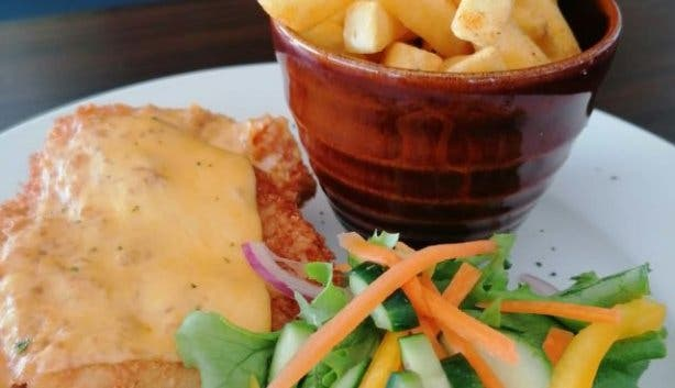 Chicken schnitzel and chips with salad