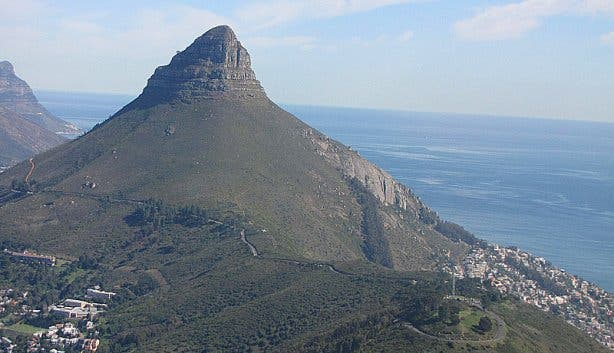 Aerial side view of Lions Head Mountain ocean