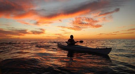 sea kayaking sunset