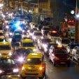 taxi cars long street at night