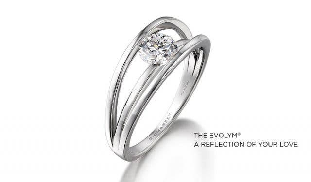 1488f89d750906 The Millennium Diamond ring. Symbolising the coming together of two lives,  this design consists of two parallel bands that act as a bridge upon which  the ...
