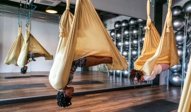 Suspended pilates, intense dance classes, hot yoga + more at this boutique  gym